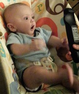 Baby_goes_crazy_over_a_remote_control