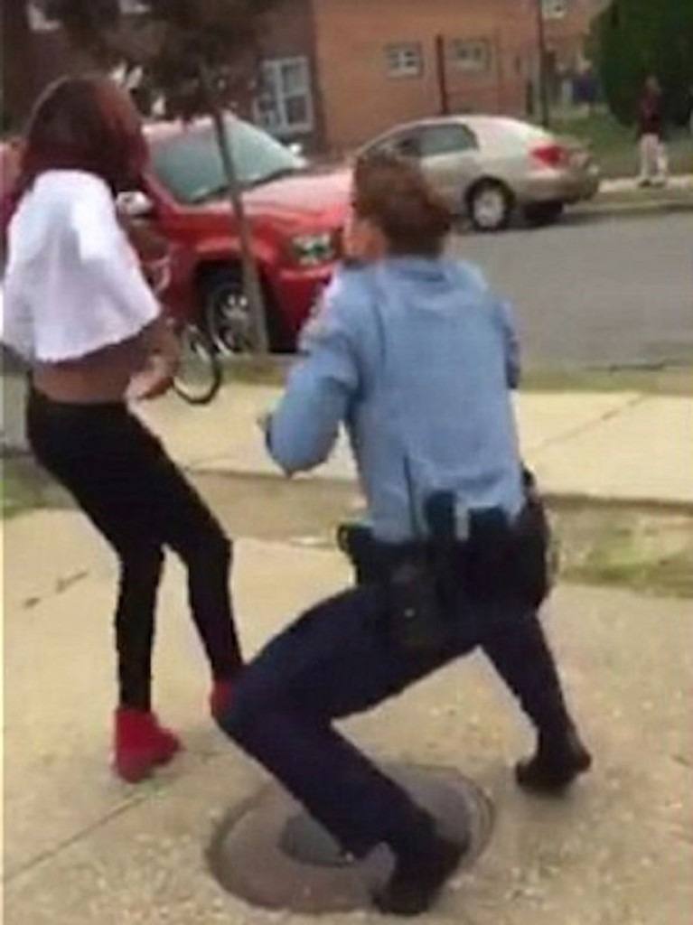 Teen-challenges-female-police-officer-to-Nae-Nae-dance-off